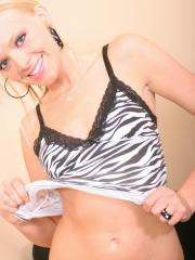 Skinny blonde teen Skye teases as she shows off her tight ass in cute panties with a zebra top on