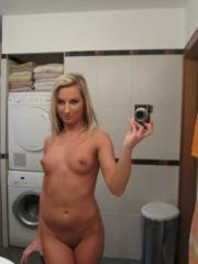 Blonde bombshell gets naked and takes selfies in the bathroom