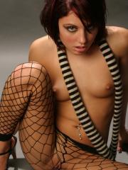 Risi Simms strips naked with her sexy scarf and black fishnets