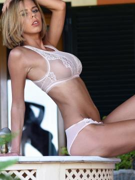 Jennifer Ann strips out of her sheer white lingerie