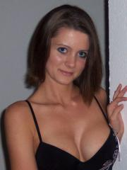 Brunette girl Southern Kalee gives a striptease in her black outfit
