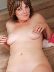 Curvy tattooed girl Misty teases as she strips naked on the stairs