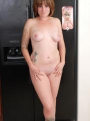 Curvy amateur Misty shows off her playful teasing side as she strips naked in the kitchen