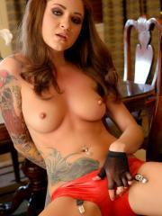 Jeska Vardinski shows off her tattooed body in skin tight latex as she slowly peels it off