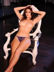 Summer St Claire shows off her perfect rack on a victorian style chair