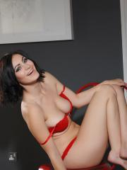 Summer St Claire poses in her red panties on a chair