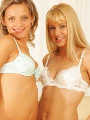 Sweet Regina gets her hot friend over for some lesbian fun in bed