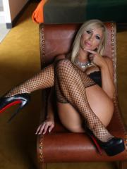 Blonde babe Tasha Reign offers you her wet pussy in black stockings