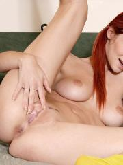 Pictures of fiery redhead Ariel releasing some built up tension.