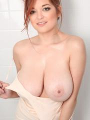 Busty redhead babe Tessa gets her boobs all soapy just for you