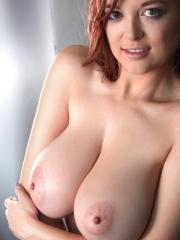 Redhead hottie Tessa Fowler shows off her big boobs in nothing but a thong