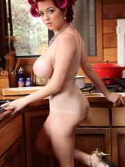 Busty redhead Tessa Fowler shows off her big boobs in the kitchen