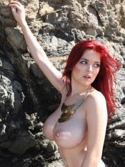 Busty redhead Tessa Fowler shows off her big boobs outside