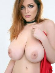 Busty redhead Tessa Fowler shows off her amazing tits