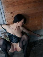 Sonya R all wet and horny sits by the wall as she penetrates her pussy with a bottle