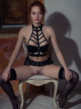 Beautiful redhead Ginger A masturbates in her black lingerie