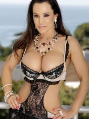 Curvy brunette Lisa Ann shows off her big boobs outside