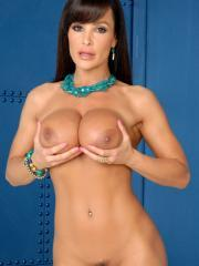 Busty brunette hottie Lisa Ann strips down to her heels whips out a dildo