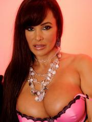 Busty hottie Lisa Ann gets dressed up in sexy lingerie just for you