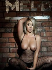 Blonde beauty Melissa Debling shows you her boobs in a fishnet bodysuit