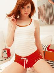 Redhead teen Nikki Leigh strips for you in bed