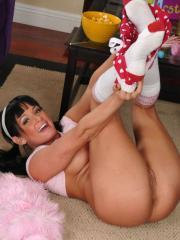 Pictures of Tory Lane dressed up as a cute teen playing with a blue dildo