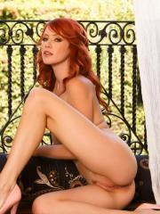 Redhead babe Elle Alexandra fondles her juicy pussy in sexy lingerie