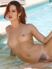 Karlie Montana sticks her fingers into her tight pussy in the pool