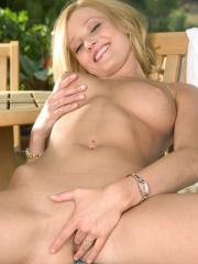 Blonde girl Carli Banks strips nude and plays with her perky tits