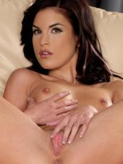 Brunette babe Nelli slides down her panties and pleasures her tight pussy