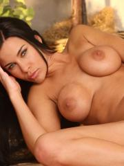 Busty brunette Laura Lee strips naked and spreads her pussy for you