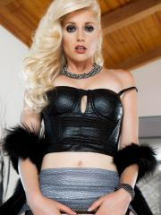 Blonde beauty Charlotte Stokely fingers her wet pussy in black fishnets