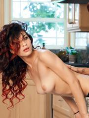 April O'Neil and Raven Rockette pleasure each other on the kitchen counter