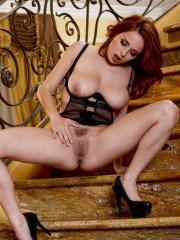 Picture sof redhead beauty Ashley Graham excitedly hitting her spot