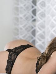Michele Monroe is all smiles with her black lacy lingerie