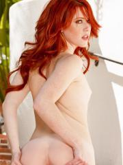Pictures of fiery redhead Elle Alexandra showing how hot her tight pussy is