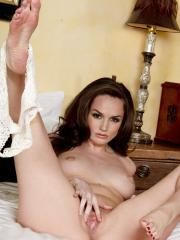 Tori Black gets playful and exposes her perky round tits