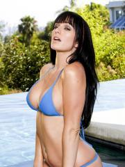 Busty babe Destiny Dixon stimulates her pussy with her fingers in the pool