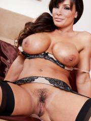 Lisa Ann strips out of her sexy lingerie and caresses her big breasts