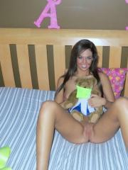 Val Midwest strips out of her yellow bra and panties in bed