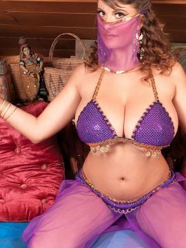 Busty girl Valory Fleur dresses as an exotic belly dancer for you