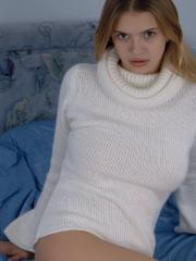 Pictures of Victoria Divine teasing in a sweater in bed