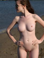 Teen hottie Emily Bloom wears only her sunglasses outside