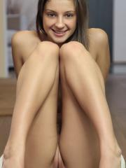 Brunette girl Masha E shows off her sexy long legs in a pair of high heels