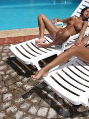 Two gorgeous teen girls bask their beauty in the sun