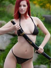 Readhead hottie Ariel wields a deadly sword