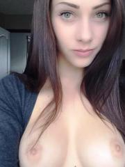Gorgeous amateur chick with fine tits posing and spreading
