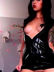 Eve takes some fetish webcam pics in a pleather dress