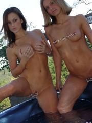 Kate and Karen are complately naked and playing with each other in the hot tub
