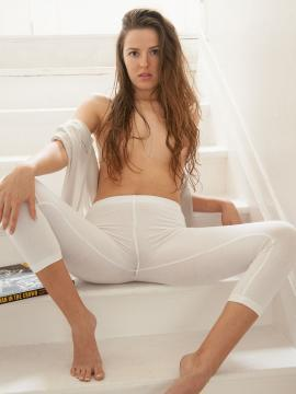 Beautiful coed Coco Rose shows her pretty ass in white tights